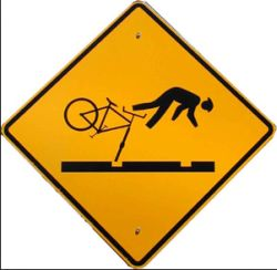 Bicycle and tram tracks sign