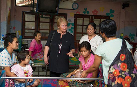 Gro Harlem Brundtland speaking to patients, Thailand, 2014 © Kaung Htet/The Elders